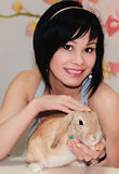Girl and pygmy rabbit Stock Image