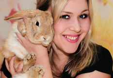 Girl and pygmy rabbit Royalty Free Stock Images