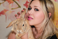 Girl and pygmy rabbit Royalty Free Stock Photos
