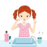 Girl In Pyjamas Brushing Her Teeth In Bathroom Stock Images