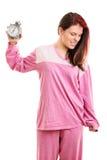Girl in pyjamas holding an alarm clock Royalty Free Stock Photo