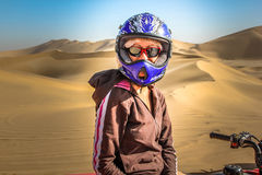 Woman in Quad. Sporty woman on the quad-bike on the high and famous dunes of Walvis Bay, Namibia, Africa Stock Image