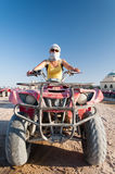 Girl on quad motorbike Royalty Free Stock Photography