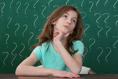 Girl With Question Mark Drawn On The Chalkboard Stock Images