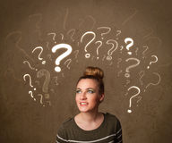 Girl with question mark symbols around her head Stock Photography