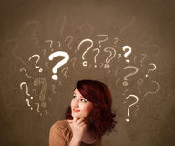 Girl with question mark symbols around her head Stock Images