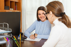 Girl questionnaire for employee. Girl written questionnaire for employee of the company at table in office Royalty Free Stock Photo