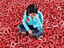 Girl among questions stock photos
