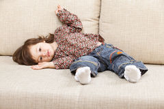 Girl quietly lying on sofa Stock Photos