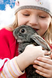 Girl and rabbit Stock Photos