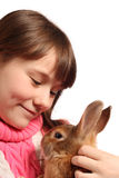 Girl with rabbit. Cute preteen girl with pet rabbit, isolated on white background Stock Image