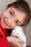 Girl and rabbit. Cute girl and white baby rabbit on her shoulder royalty free stock photography