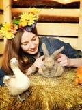 Girl With Rabbit Stock Image