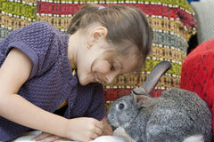 Girl and Rabbit Stock Photo
