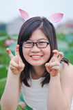 Girl with rabbit ears Stock Photo