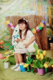 Girl and rabbit Stock Images