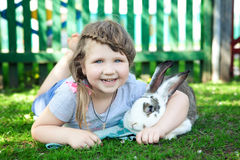 Girl with rabbit Stock Photos