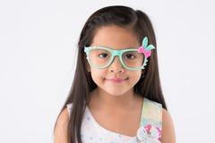 Girl in rabbit glasses Stock Image