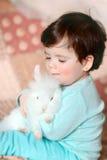 Girl and rabbit Stock Image