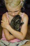 Girl and rabbit pet stock image
