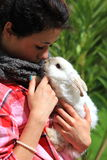 Girl and Rabbit. Young girl holding her pet rabbit  (breed is angora Royalty Free Stock Photos