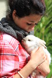 Girl and Rabbit. Young girl holding her white angora rabbit Royalty Free Stock Photos