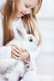 Girl and rabbits Royalty Free Stock Image