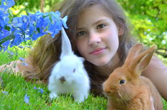 Girl with rabbits Stock Photography