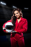 Girl racer with helmet at stadium Stock Photos