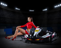 Girl racer with kart at stadium Royalty Free Stock Photography