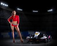 Girl racer with kart at stadium Stock Photography