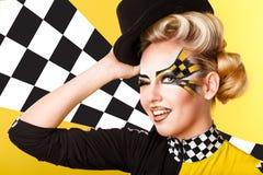 Girl racer winks. Stock Photo