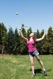 Girl with racket and ball on backyard Stock Image