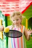 Girl with racket and ball Stock Photo