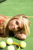 Girl with racket and balls Stock Photos