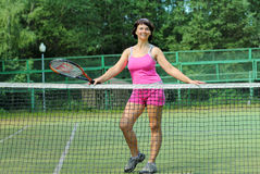 Girl with racket Stock Images