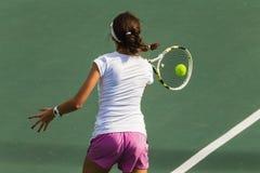 Girl Tennis Hits Ball  Stock Images