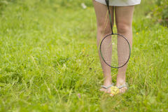 The girl with a racket. The girl`s legs with a racket Royalty Free Stock Photo