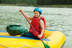 Girl  on the raft. Girl with a paddle on the raft Stock Images