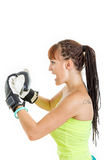 Girl in rage wearing boxing gloves ready to fight and standing a. Angry girl in rage wearing boxing gloves ready to fight and standing aside in combat position stock images