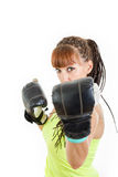 Girl in rage wearing boxing gloves ready to fight and standing i. Angry girl in rage wearing boxing gloves ready to fight and standing in combat position and stock photo