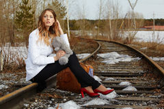 Girl on rail Stock Photography