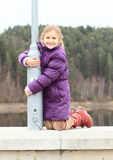 Girl on railing of dam Royalty Free Stock Photography
