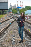 Girl at railroad Stock Images