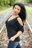 Woman on the railroad Stock Image