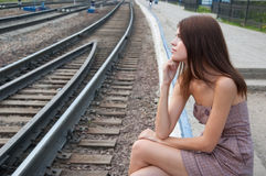 Girl on railroad tracks Royalty Free Stock Image