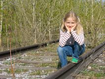 Girl on the rails royalty free stock photo