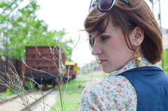 The girl in railway park Royalty Free Stock Photo
