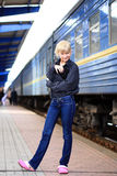 The girl at railway station Stock Image