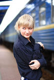 The girl at railway station Stock Images